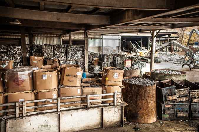 warehouse-barrels-of-scrap-material